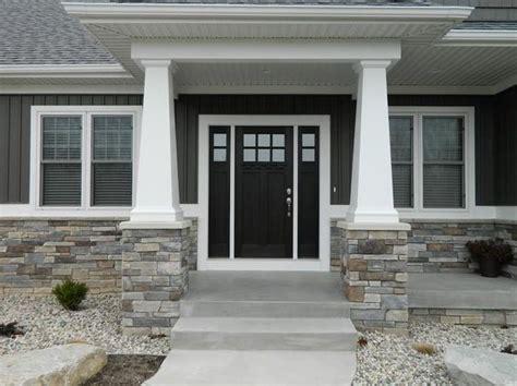 dark gray siding exterior craftsman  white window trim
