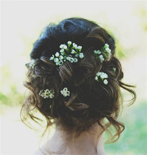 formal hairstyles with flowers prom hair updo loose flowers prom hair pinterest