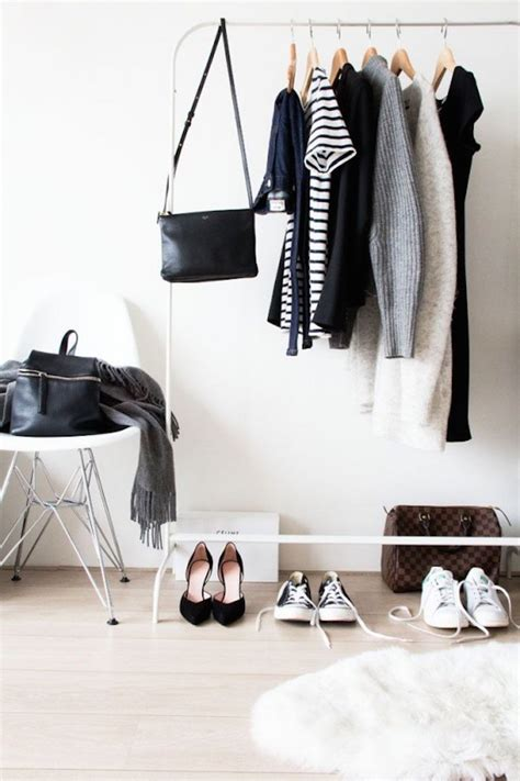 simple and minimalist white clothing rack decoist