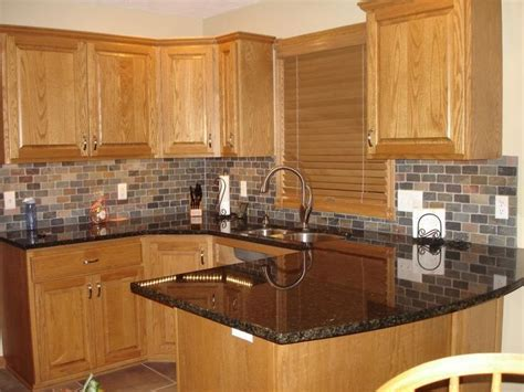 honey oak kitchen cabinets with black countertops