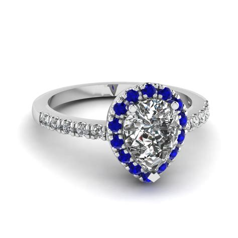 pear shaped halo engagement ring with sapphire in