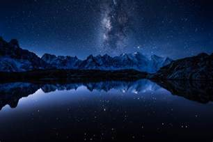 the milky way in the sky above a mountain lake wallpapers