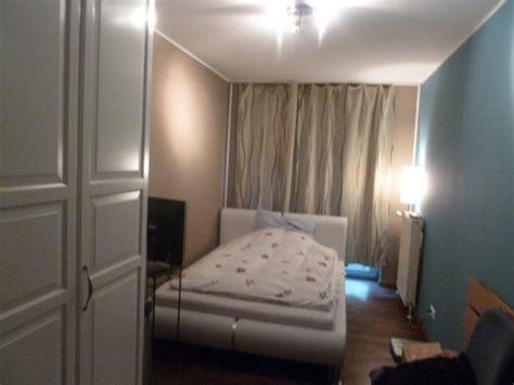 schlafzimmer und wohnzimmer in einem