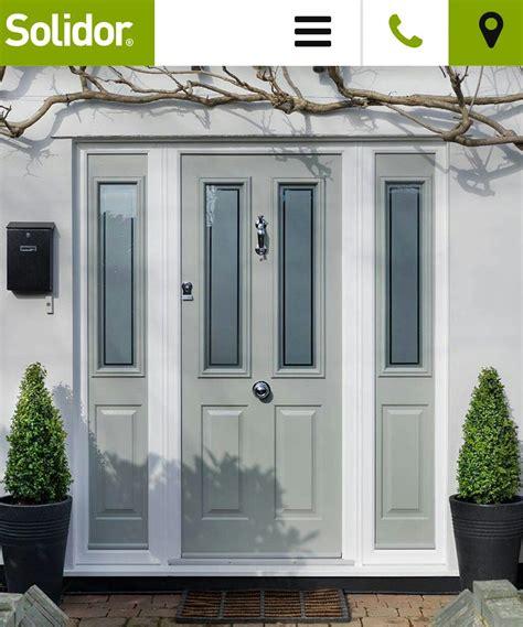 front doors at grey green composite front door and side panels front