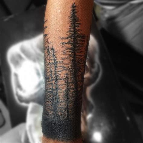 lower arm black ink forest tree tattoo golfian com