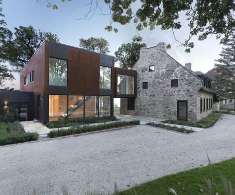 old modern modern steel cubes complement 200 year old stone house