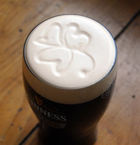 polystyrene ireland logo in the foam clover in a pint of guiness at