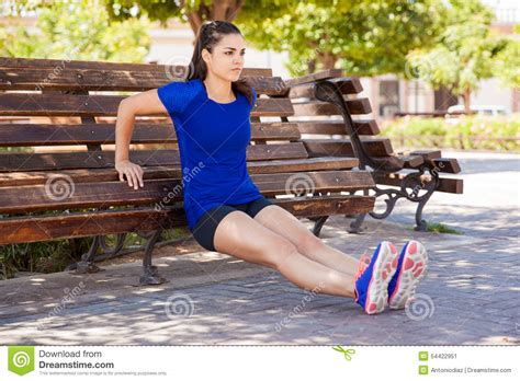 women bench tricep dips on a park bench stock photo image 54422951