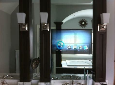 tv behind bathroom mirror two popular ways of installing audio video in your bath