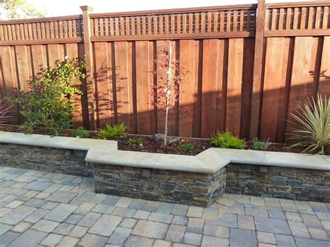 backyard walls brick paver planters against fence backyard paving