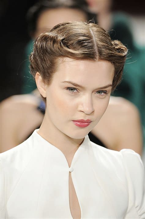up dos in the 40s a chic 40s style rolled updo kept the hair off the face
