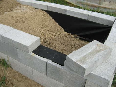 construction of concrete block garden bed liner on sides