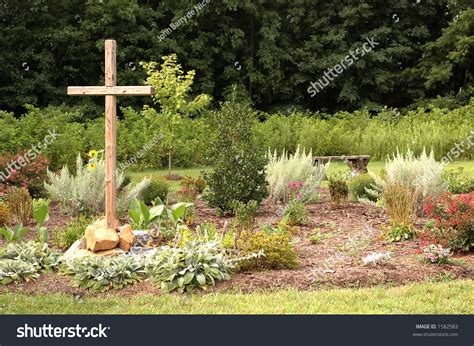 Garden With Cross Wooden Cross In Flower Garden Stock Photo 1582583