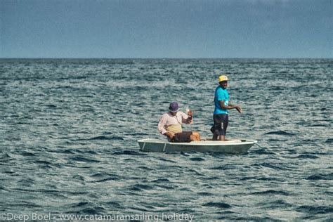 party boat fishing st george island stylish young men fishing in caribbean sea catamaran