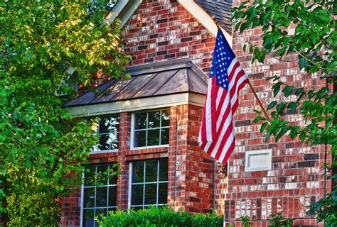 hanging flag on house american flag hanging on the front of the house symonds flags poles inc