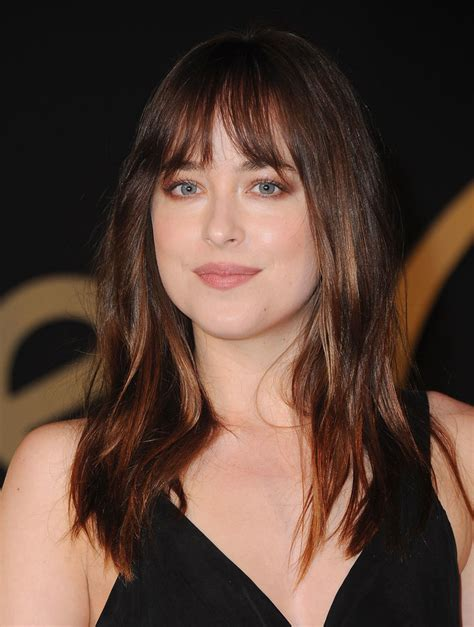 dakota johnson bangs hiw to cut growing out bangs gracefully is doable here s how