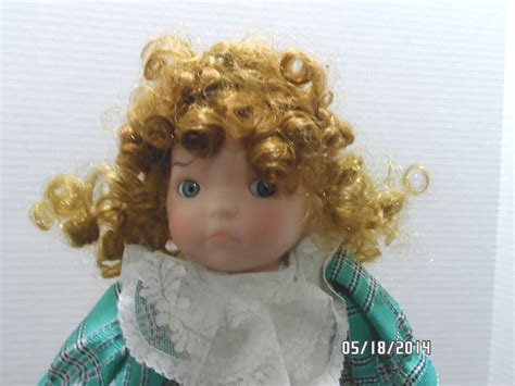 porcelain doll 1990 1990 porcelain doll made by the heritage mint ltd