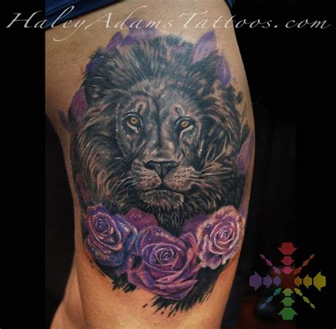 rose and lion tattoo with roses by tattoos