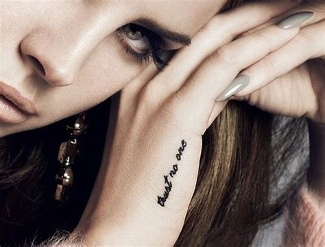 lana del rey hand tattoo quot trust no one quot style