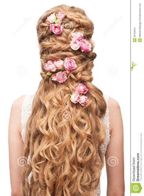 hairstyles decorated with flowers woman with curly long hair royalty free stock photo