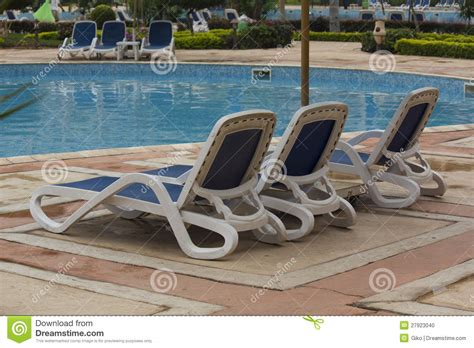 Lounge Chairs In Pool Design Ideas Swimming Pool Lounge Chairs Stock Photo Image 27923040