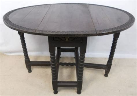 carved oak small oval gateleg dining table