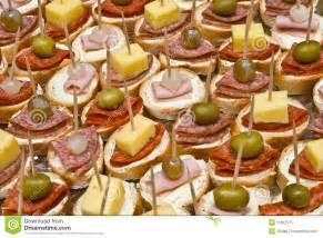 Party appetizers on wooden sticks royalty free stock photo image