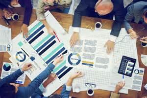 Business people meeting planning analysis statistics brainstorming
