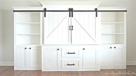 family and the lake house she s here welcome home - White Barn Door Entertainment Center