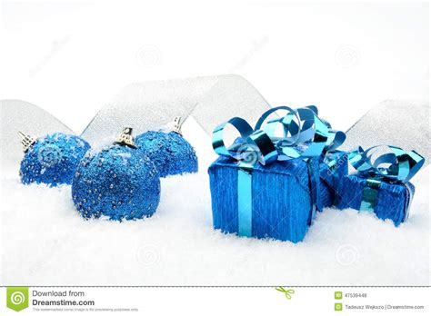 blue christmas gifts baubles silver ribbon on snow stock