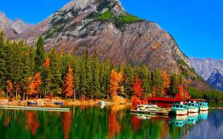 Fall colors on lake banff in canada boats hd wallpaper 86053