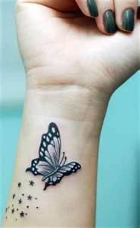 small butterfly tattoos on hand design idea