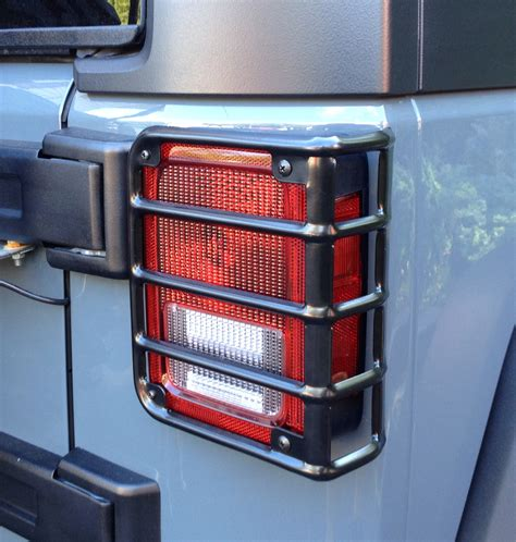 jeep tail light guard 5 great jeep jk upgrades for under 100 dollars