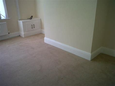 Fitting Laminate Flooring Skirting Boards by Carefree Plastering Services Manchester Manchester