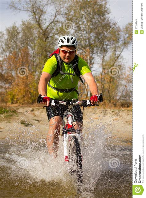 Kaos Rocky Bike Graphic 1 Oceanseven athlete crossing rocky terrain with bicycle in his stock photo image 60393948