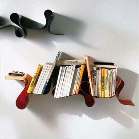 kartell s new bookshelf fuses with practical
