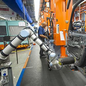 bmw factory robots robots lend an arm to automotive workers