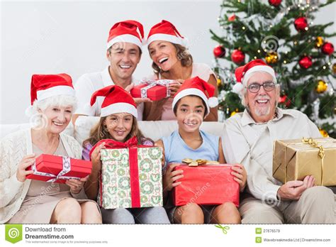 family exchanging christmas presents stock image image