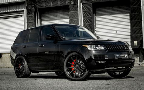 black land rover blacked out range rover