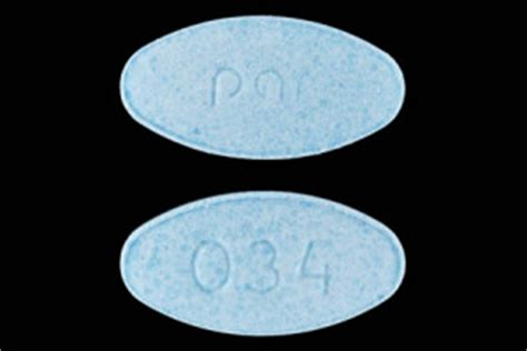 Light Blue Oval Pill by White Pill With Markings Apo 034