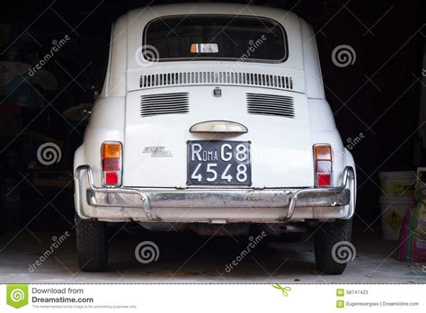 white fiat 500 l car stands in garage editorial
