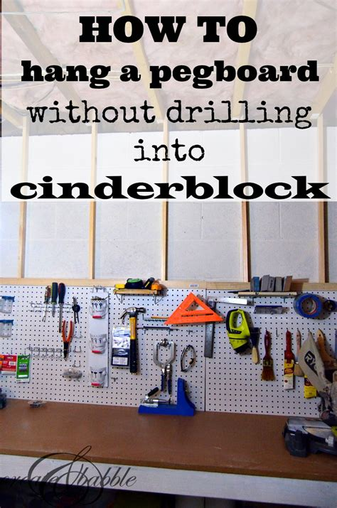 how to hang pictures how to hang a pegboard without drilling into cinder block
