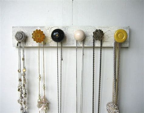 Door Knob Necklace Holder by Hanging Jewelry Organizer With Yellow And Gray Knobs
