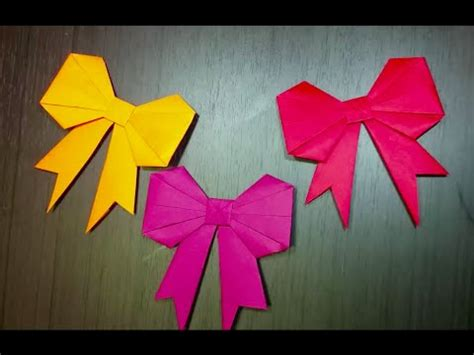 How To Fold Paper Ribbon - origami papercraft folding paper ribbon or bow
