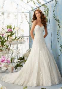 embroidered lace appliques on net with scalloped hemline