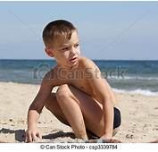 Stock Photo Of On A Beach  Young Boy 6 Years Old Sits