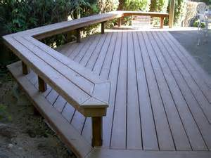 trex deck benches up to concrete patio decks