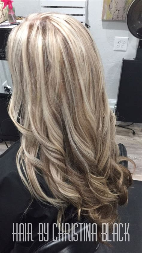 highlights with lowlights underneath ash blonde highlights with chocolate brown lowlights and