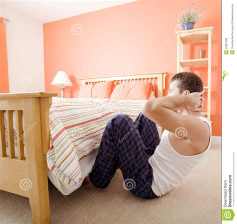 sit ups in bed man doing sit ups in bedroom royalty free stock image