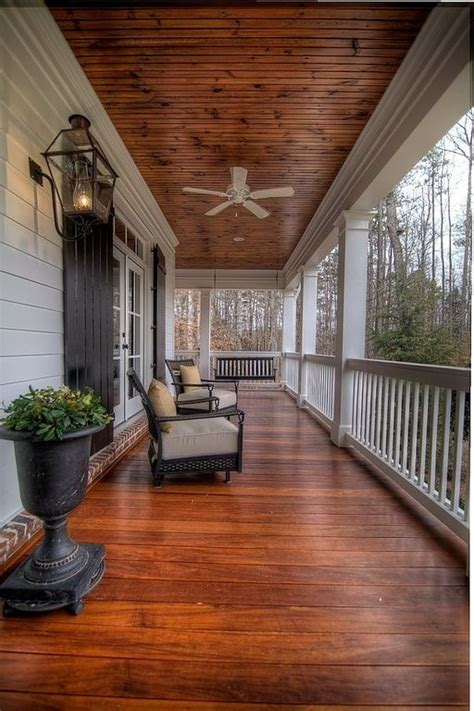 wrap around front porch traditional porch with bellawood select patagonian rosewood exterior paint transom window